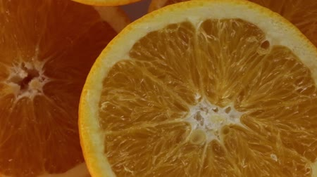 Oranges cut in half for juice Stock Footage