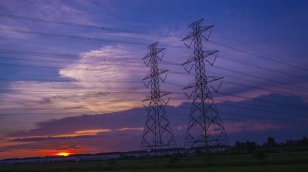 kutup : Electric pole, High voltage towers and sky sunset day to night, Timelapse Stok Video