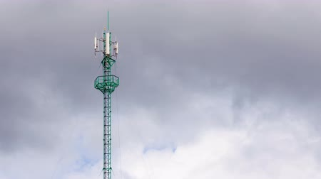 telekomünikasyon : Communications Tower mobile antenna pole and blue sky cloud moving 4K, Timelapse