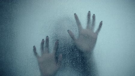 wampir : female hand and head, spooky shadows on the glass wall, in full HD, Horror movie scene
