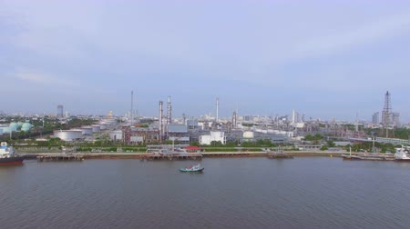 rurociąg : aerial top view of Oil refinery or factory and container transportation ship on chao phraya river, transportation concept, panning dolly camera shot, High quality footage 4K