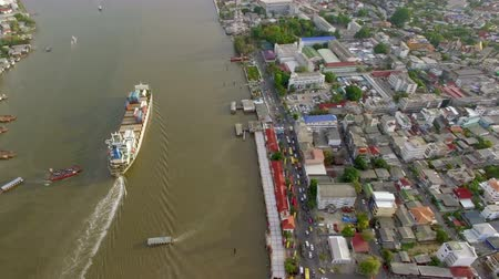 river ocean : aerial top view of container transportation ship on chao phraya river, transportation concept, tilt-up camera shot, High quality footage 4K
