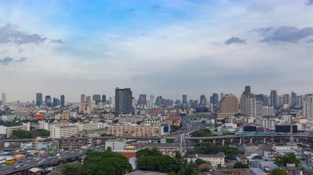 crowded : View of Business Building Bangkok city Asia Thailand. landscape area with transportation road and sky, day to night twilight. Transportation concept High quality in 4K Timelapse