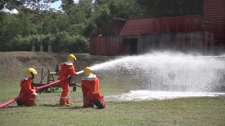 нападение : Fireman or fire fighters group and emergency workers, they valiantly tried to rescue people by injecting spray foam tactic as slow motion