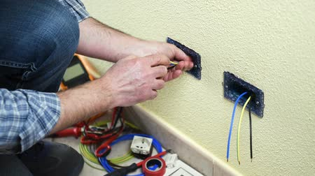 direto : Electrician technician worker insert the electrical socket. Construction industry. Building. Footage. Stock Footage