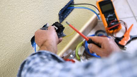 installer : Electrician technician worker inserts and fixes Construction industry. Building. Footage. Stock Footage