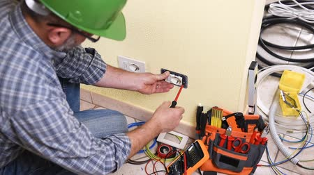 installer : Electrician technician worker with screwdriver Construction industry. Building. Footage.