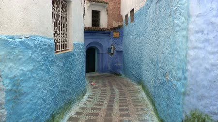 marrocos : Blue Alley In Chefchaouen, Morocco. Chefchaouen is a city in northwest Morocco famous for its blue buildings. Other views available.