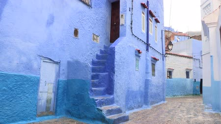 parede : Rainy Blue Alley In Chefchaouen, Morocco. Chefchaouen is a city in northwest Morocco famous for its blue buildings. Other views available. Vídeos