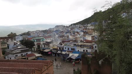 базарная площадь : Wide cityscape of Chefchaouen, Morocco on an overcast day. Chefchaouen is a city in northwest Morocco famous for its blue buildings. Other views available.