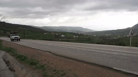 марокканский : White SUV passes by on paved highway in Northern Morocco near El Hoceima.