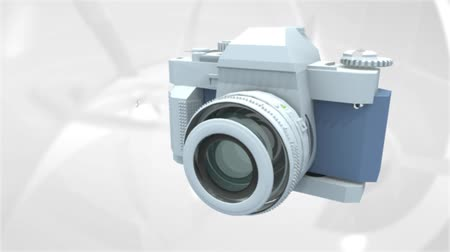 objektiv : 3D loopable animation of different elements coming together forming a camera