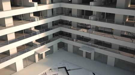 blocks of flats : 3D render animation in 4K of a building under construction with cranes on top of blueprints