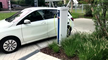 electric : electric car being charged