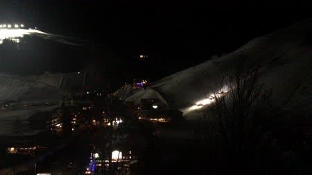 floodlight : Motion timelapse of ski resort at night Stock Footage
