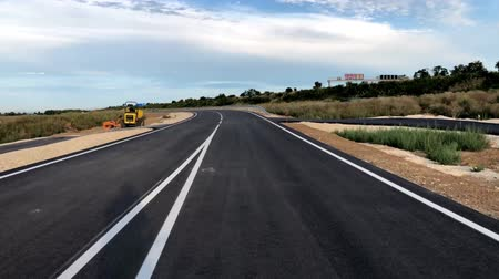 bicycle riding on a freshly paved and marked road