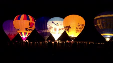The glow of hot air balloons at night during the World Ploughing Competition in Germany 2018 Stock mozgókép