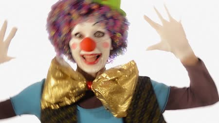 palhaço : A funny pretty clown going back and forth over white background