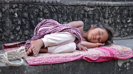 babygirl : young girl sleeping in angkor wat temple, cambodia Stock Footage