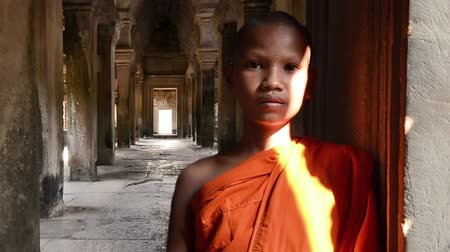 clergyman : cambodian monk in angkor wat temple dolly shot