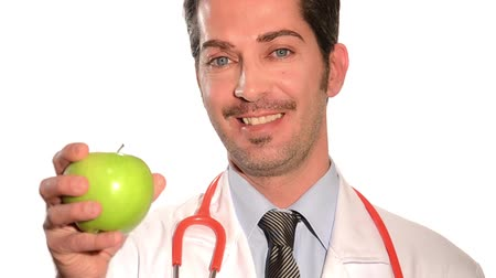 vitaminic : Medical doctor showing an apple over white background