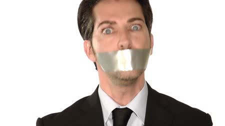 gag : Businessman gagged with adhesive tape on mouth on white background