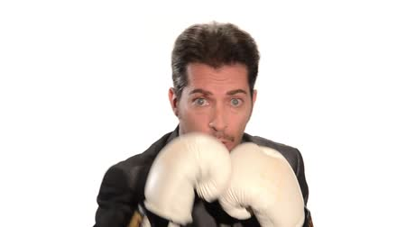 yarışma : Businessman punching with boxing gloves on white background. Conceptual footage. A manager against his competitors.