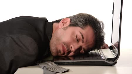 komputer : Stressed and tired businessman sleeping on his laptop over a white background