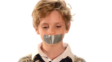 tied : abused child, Beautiful blond child with adhesive on his mouth isolated over white Stock Footage