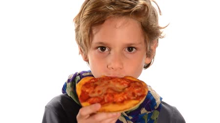 menő : handsome child eating a pizza, Portrait of a blond kid eating an italian pizza on white background
