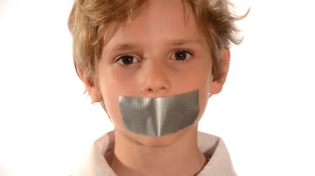tied : abused child, Beautiful child with adhesive on his mouth isolated over white Stock Footage
