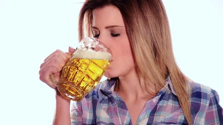 фастфуд : Modern beautiful girl is drinking a beer on white background