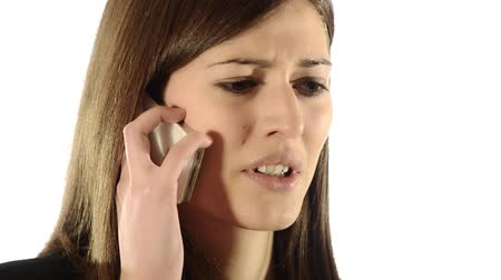 сердитый : brunette girl quarreling on the telephone