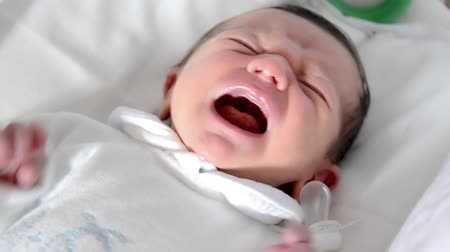 newborn child : newborn baby boy crying