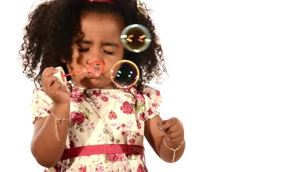 латинский : funny  brazilian little girl isolated blowing soap bubbles