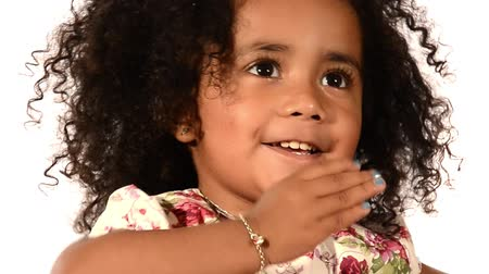 little finger : funny mixed race black and latino brazilian little girl isolated Stock Footage