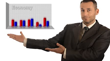 hiány : Handsome businessman showing graph over white background