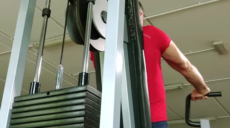 dorsal : brawny man doing workout at the gym, pectoral machine