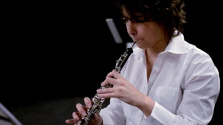 clarinet : young musician woman playing oboe
