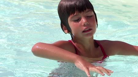 eyes closed : young girl in a swimming pool