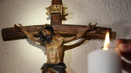 ježíš : Wooden cross and carving of Jesus being crucified on the cross.