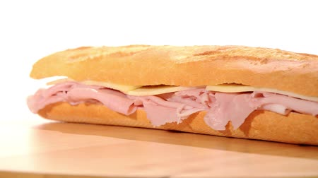 winkelen : Ham en kaas sandwich Stockvideo