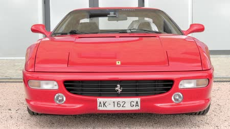 berlinetta : Ferrari S.p.A. is an Italian luxury sports car manufacturer based in Maranello. Ferrari road cars are generally seen as a symbol of speed, luxury and wealth. Stock Footage