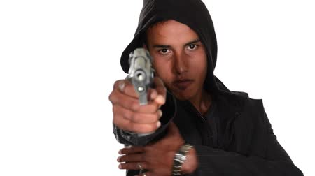 марокканский : young black man pointing gun isolated on white Стоковые видеозаписи