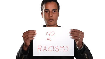 igual : Young man with a sign no racism. Stop racism campaigne. Spanish version. Stock Footage
