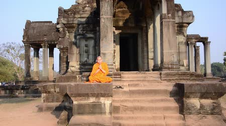 clergyman : cambodian monk in angkor wat temple