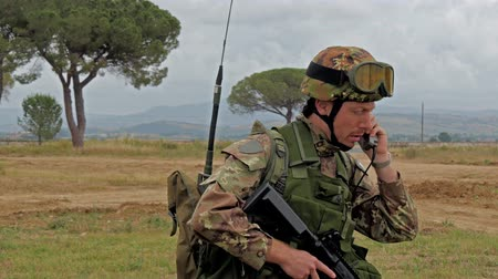 asker : Italian Army. Military Exercise. soldier talking on radio, training