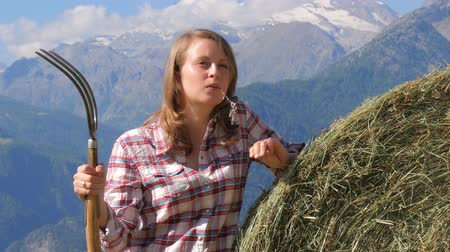 hayloft : beautiful farm girl with pitchfork Stock Footage