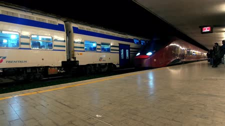 modern train wagon : Train Station in Florence Italy, Italo train arrives. Stock Footage