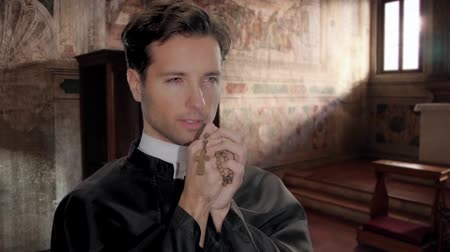 modlitba : young catholic priest saying a prayer